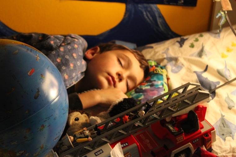 Asleep, with toys